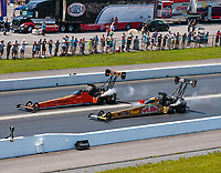 Jun 17, 2018; Bristol, TN, USA; NHRA top fuel driver Mike Salinas (far) defeats Leah Pritchett during the Thunder Valley Nationals at Bristol Dragway. Mandatory Credit: Mark J. Rebilas-USA TODAY Sports