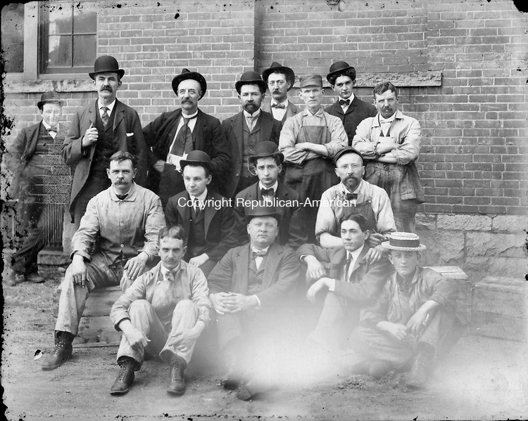 Frederick Stone negative. Group of unidentified men, some appearing to be workers, others management. There is one figure in the rear far left that looks as though the photographer wanted to delete from the image. The glass negative is scratched heavily in this area as though intentional.