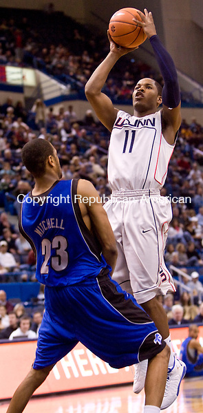 HARTFORD, CT - 18 JANUARY 2009 -011809JT05-<br /> UConn's Jerome Dyson takes a shot above Seton Hall's Robert Mitchell during Sunday's game at the XL Center in Hartford. UConn won, 76-61.<br /> Josalee Thrift / Republican-American