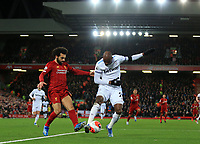 24th February 2020; Anfield, Liverpool, Merseyside, England; English Premier League Football, Liverpool versus West Ham United; Mohammed Salah of Liverpool  competes for the ball with Angelo Ogbonna of West Ham United