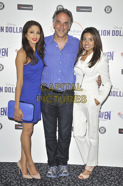 LONDON, ENGLAND - JULY 14: Neerja Naik, Jeffrey D Brown &amp; Seirah Royin attend the London Indian Film Festival 'Million Dollar Arm' UK film premiere, Cineworld Shaftesbury Avenue cinema, Coventry St., on Monday July 14, 2014 in London, England, UK. <br /> CAP/CAN<br /> &copy;Can Nguyen/Capital Pictures