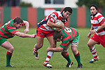 Siale Piutau goes for the gap between Grant Henson & Dallen Olson. Counties Manukau Premier Club Rugby game between Waiuku & Karaka played at Waiuku on Saturday July 4th 2009. Waiuku won the game 22 - 7.