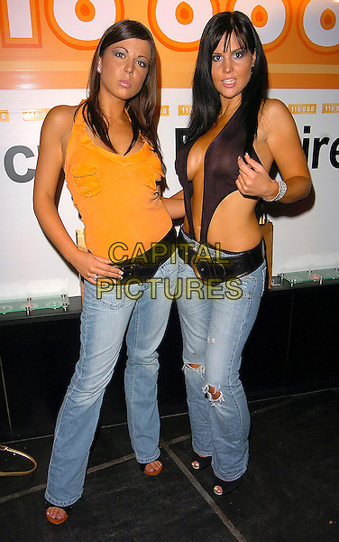 EMMA GREENWOOD & MICHELLE BASS .118 888 New Campaign Launch Party at Trap, 201 Wardour Street, London, W1..August 1st, 2005.full length jeans denim orange tank top black plunging neckline cut away top cleavage belly stomach midriff.www.capitalpictures.com.sales@capitalpictures.com.©Capital Pictures