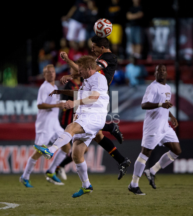 Dan Metzger (7) of Maryland goes up for a header with Eric Walker (22) of Pittsburgh during the game at Ludwig Field on the campus of the University of Maryland in College Park, MD.  Maryland defeated Pittsburgh, 2-0.