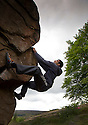 29/06/14<br /> <br /> Kishan Vekaria from Warwick University Climbing club defies gravity on a boulder the size of a house.<br /> <br /> To mark the 70th anniversary of the British Mountaineering Council (BMC), climbers flock to Stanage Edge near Hathersage, in the Derbyshire Peak District to compete in climbing and bouldering competitions held over the weekend at the Stanage Festival 2014.<br />  <br /> All Rights Reserved: F Stop Press Ltd. +44(0)1335 300098   www.fstoppress.com.