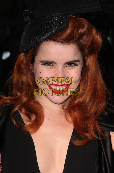 PALOMA FAITH .Arrivals at The Love Ball, the Roundhouse, Camden, London , England, UK, February 23rd 2010.portrait headshot black red lipstick make-up hat smiling gold eyeshadow .CAP/JIL.©Jill Mayhew/Capital Pictures.
