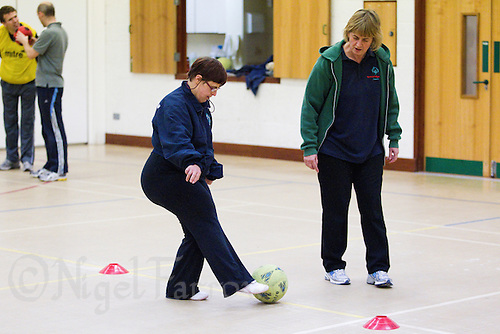 20 OCT 2011 - DISS, GBR - Jill Dawson aids one of the members of the Diss Ability multi sport club for people with learning disabilities that she helped to found (PHOTO (C) NIGEL FARROW)