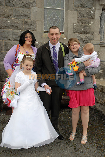 Sarah Scully Saputo who made her First Holy Communion on Saturday at Tullyallen Church pictured with her parents Maeve and Bruno and sisters Rebecca and Isabella (7months).