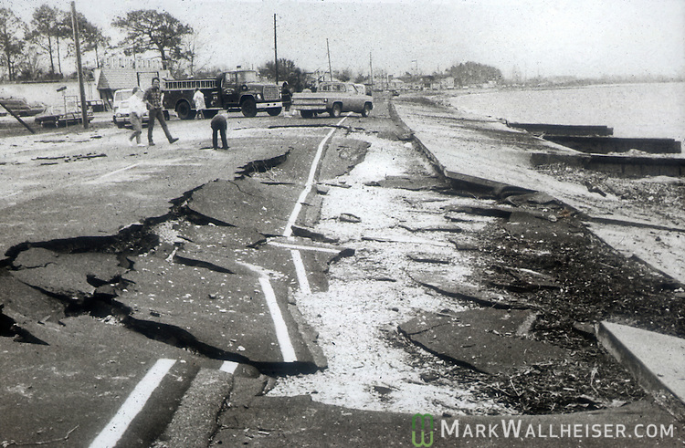 Damage roadways on Alligator Point as Hurricane Elena churned in the Gulf of Mexico off the coast of the Florida panhandle in September 2, 1985.  Elena was the first major hurricane of the 1985 season and it's unusual path included a loop and went back and fourth along the Florida panhandle as a category 3 storm heavily damaging the Apalachicola, FL oyster industry.  Apalachicola recorded the highest surge and rainfall totals and whatever oyster industry wasn't ruined by Elena was finished off when Hurricane Kate followed  in November of the same season.