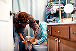 "Karen Morris has been caring for her mother Gloria, 80, for the past 10 years. Her mother has Alzheimer's disease and lives with Karen and Karen's husband Richard in their Charlotte, NC home. She cleans under her mother's nails before getting her completely dressed...Mrs. Morris was a nurse before she retired and really enjoys taking care of people, she said. Every morning she washes her mother in the bathroom, helps her walk down the stairs, and they share breakfast, as they did Monday, October 18, 2010...Gloria was having an especially bad day and because Karen sees her every day, she knew something was wrong. She later discovered her medication was dehydrating her. That is one of many reasons why having a regular caretaker is so important. ..Released: Yes.""Caretaker"".Assignment c/o Ilene Bellovin"