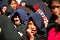 Indigenous women wait for food and drink rations on the island of Taquile in Lake Titicaca off Puno, Peru, on May 12, 2008. The inhabitants, Taquileños, are known for their fine handwoven textiles and clothing, which are regarded as among the highest-quality handicrafts in Peru.