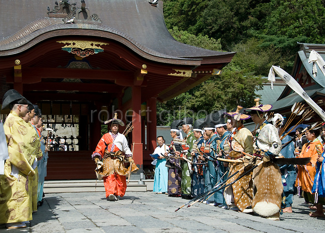 Kiyoharu Ogasawara of the Ogasawara school of yabusame horseback archery walks through the shrine grounds during the annual Reitaisai Grand Festival at Tsurugaoka Hachimangu Shrine in Kamakura, Japan on  14 Sept. 2012.  Sept 14 marks the first day of the 3-day Reitaisai festival, which starts early in the morning when shrine priests and officials perform a purification ritual in the ocean during a rite known as hamaorisai and limaxes with a display of yabusame horseback archery. Photographer: Robert Gilhooly