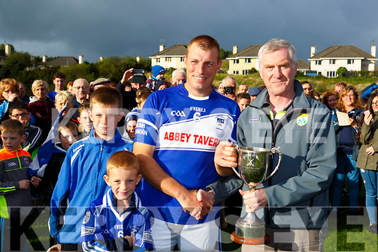 Kerry PRO presents the cup to St Brendans captain Denis Moriarty after they defeated Kilgarvan in the County Intermediate Hurling Championship final in killarney on Saturday
