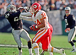 Oakland Raiders vs. Kansas City Chiefs at Oakland Alameda County Coliseum Sunday, November 5, 2000.  Raiders beat Chiefs  49-31.  Oakland Raiders defensive back Johnnie Harris (37) attempts to tackle  Kansas City Chiefs running back Mike Cloud (34).