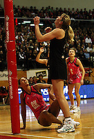 World 7 goal keep Geva Mentor watches Irene van Dyk's shot at goal during the International  Netball Series match between the NZ Silver Ferns and World 7 at TSB Bank Arena, Wellington, New Zealand on Monday, 24 August 2009. Photo: Dave Lintott / lintottphoto.co.nz