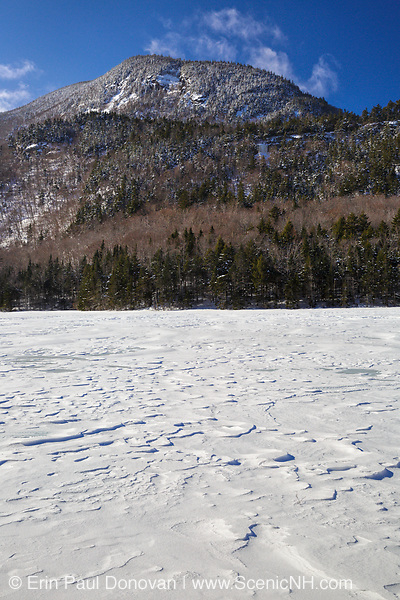 Beaver Pond in Kinsman Notch of the White Mountains, New Hampshire USA during the winter months. Jakey's Crag is in the background.