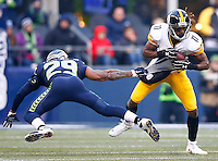 Markus Wheaton #11 of the Pittsburgh Steelers evades a tackle by Earl Thomas #29 of the Seattle Seahawks during the game at CenturyLink Field on November 29, 2015 in Seattle, Washington. (Photo by Jared Wickerham/DKPittsburghSports)