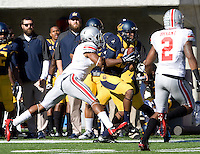 James Grisom of California catches a pass from California quarterback Jared Goff during the game against Ohio State at Memorial Stadium in Berkeley, California on September 14th, 2013.  Ohio State defeated California, 52-34.