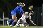 30 November 2013: North Carolina's Summer Green (6) is fouled by UCLA's Jenna Richmond (left). The University of North Carolina Tar Heels played the University of California Los Angeles Bruins at Fetzer Field in Chapel Hill, North Carolina in a 2013 NCAA Division I Women's Soccer Tournament Quarterfinal match. UCLA won the game 1-0 in two overtimes.