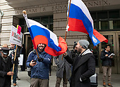 Protestors waive Russian flags after the departure of former adviser to United States President Donald J. Trump, Roger Stone, who appeared at the US District Court in Washington, DC to be arraigned on an indictment brought by special counsel Robert Mueller on January 29, 2019.  The allegations against the longtime Trump associate say he sought stolen emails from WikiLeaks that could potentially damage Trump's opponents while working in coordination with senior Trump campaign officials.  Stone plead innocent to all of the charges.<br /> Credit: Ron Sachs / CNP<br /> (RESTRICTION: NO New York or New Jersey Newspapers or newspapers within a 75 mile radius of New York City)