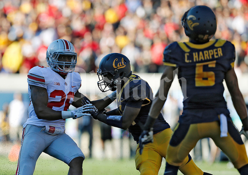 Ohio State Buckeyes cornerback Armani Reeves (26) tries to get past California Golden Bears cornerback Cameron Walker (14) on a punt in the 2nd quarter at Memorial Stadium in Berkeley, California on September 14, 2013.  (Dispatch photo by Kyle Robertson)