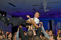 The Bar Mitzvah boy being lifted during the hora dance.