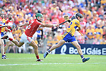 Goal...David Reidy of Clare in action against Eoin Cadogan of Cork during their Munster senior hurling final at Thurles. Photograph by John Kelly.