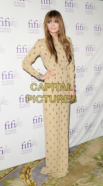 MISCHA BARTON.Fifi UK Fragrance Awards 2009, The Dorchester hotel, London, England..April 22nd 2009.full length long maxi gold long sleeved sleeves yellow dress hand on hip beige sequins sequined.CAP/CAN.©Can Nguyen/Capital Pictures.
