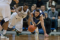 January 14, 2012:   Jacksonville Dolphins forward Delwan Graham (21) and East Tennessee State Buccaneers guard Adam Sollazzo (43) dive for a loose ball during Atlantic Sun conference action between the Jacksonville University Dolphins and East Tennessee State University Buccaneers at Veterans Memorial Arena in Jacksonville, Florida.   East Tennessee State defeated Jacksonville 72-58.