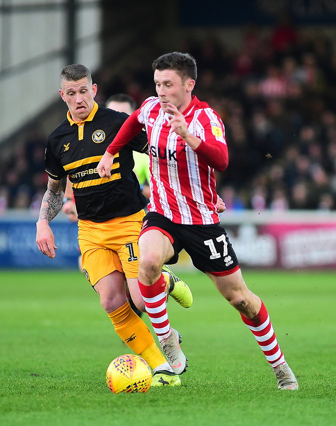 Lincoln City's Shay McCartan gets past Newport County's Scot Bennett<br /> <br /> Photographer Andrew Vaughan/CameraSport<br /> <br /> The EFL Sky Bet League Two - Lincoln City v Newport County - Saturday 22nd December 201 - Sincil Bank - Lincoln<br /> <br /> World Copyright © 2018 CameraSport. All rights reserved. 43 Linden Ave. Countesthorpe. Leicester. England. LE8 5PG - Tel: +44 (0) 116 277 4147 - admin@camerasport.com - www.camerasport.com