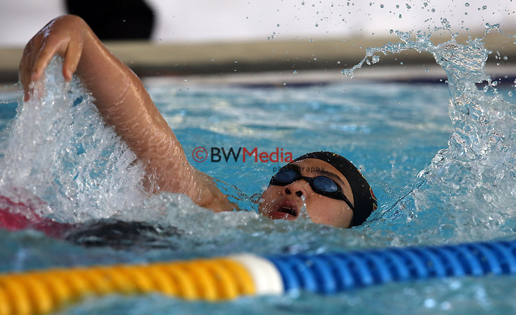 An athlete competes in the Backstroke discipline during the Swimming New Zealand Division II Championships, Moana Pool, Dunedin, Friday 20 March 2015. Photo: Rob Jefferies/www.bwmedia.co.nz