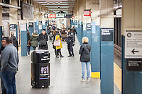 An NYPD officer assists travelers at his post in the New York subway in Times Square on Tuesday, March 22, 2016. Security in New York has been heightened in the wake of the terrorist bombings in Brussels, Belgium. (© Richard B. Levine)
