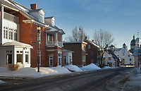 Houses on the Rue des Ursulines, an old road built in 1650, in Trois-Rivieres, Mauricie, on the Chemin du Roi, Quebec, Canada. On the far right is the dome of the Chapelle des Ursulines, part of the Monastere des Ursulines, begun 1699. The Ursuline nuns arrived in Trois-Rivieres in 1697 to provide the town with a school and a hospital. The Chemin du Roy or King's Highway is a historic road along the Saint Lawrence river built 1731-37, connecting communities between Quebec City and Montreal. Picture by Manuel Cohen