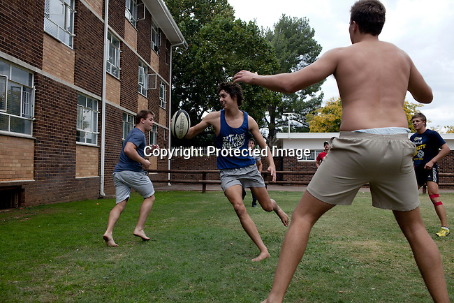BLOEMFONTEIN, SOUTH AFRICA APRIL 17, 2013: Students play rugby during a 4pm tea break at the Armentum residence at the University of the Free State in Bloemfontein, South Africa. Photo by: Per-Anders Pettersson