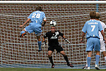 06 September 2009: UNC's Alex Waters (28) heads the ball towards Evansville's Phil Boerger (18). The University of North Carolina Tar Heels defeated the Evansville University Purple Aces 4-0 at Fetzer Field in Chapel Hill, North Carolina in an NCAA Division I Men's college soccer game.