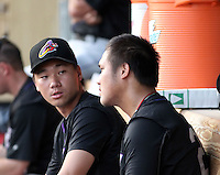 Fellow Taiwanese natives Chen-Chang Lee #12 and  Chen Chun #29 of the Akron Aeros talk on the bench during a game against the Harrisburg Senators at Metro Bank Park on June 10, 2011 in Harrisburg, Pennsylvania.   ..Photo By Bill Mitchell/Four Seam Images