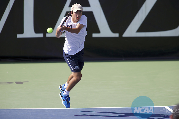 25 MAY 2016: Noah Farrell of Middlebury College returns a volley in his doubles match during the Division III Men's Tennis Championship, at Stowe Stadium in Kalamazoo, MI. Bowdoin College defeated Middlebury 5-0 for the national title. Tony Ding/NCAA Photos