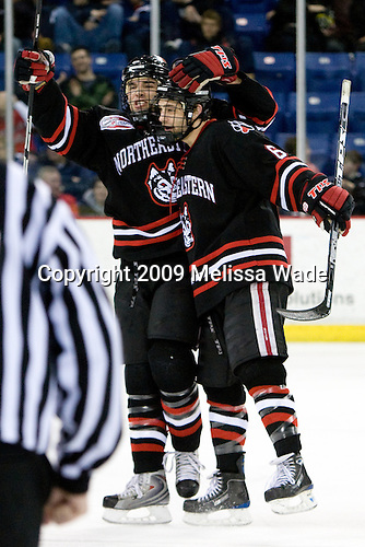 Dennis McCauley (Northeastern - 12), David Strathman (Northeastern - 6) - The Northeastern University Huskies defeated the University of Massachusetts-Lowell Riverhawks 3-1 on Saturday, February 28, 2009, at the Paul E. Tsongas Arena in Lowell, Massachusetts.