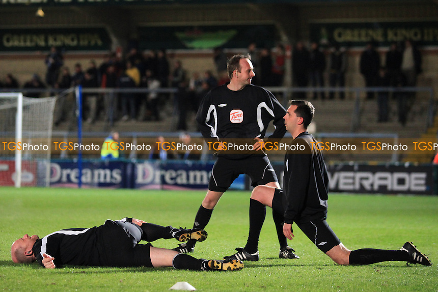 Referee Mr D Phillips and his Assistants get ready for the match with a few exercises - Wycombe Wanderers vs Leyton Orient - nPower League One Football at Adams Park, High Wycombe - 06/03/12 - MANDATORY CREDIT: Paul Dennis/TGSPHOTO - Self billing applies where appropriate - 0845 094 6026 - contact@tgsphoto.co.uk - NO UNPAID USE.