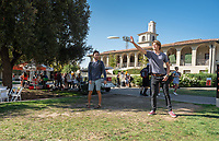 Students play with a flying disc (frisbee) near the Academic Quad on a sunny Friday, November 9, 2018.<br /> (Photo by Marc Campos, Occidental College Photographer)
