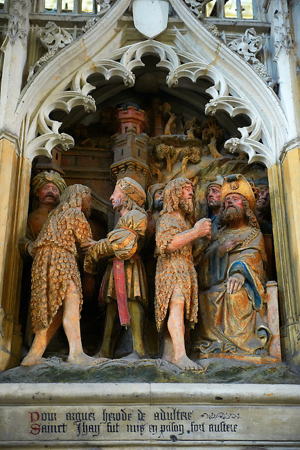 Gothic sculptiures of scenes from the life of John The Batist. Gothic Cathedral of Notre-Dame, Amiens, France
