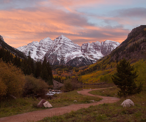 Snow on the Maroon Bells in autumn, west of Aspen, Colorado. John offers fall foliage photo tours throughout Colorado. .  John leads hiking and photo tours throughout Colorado.
