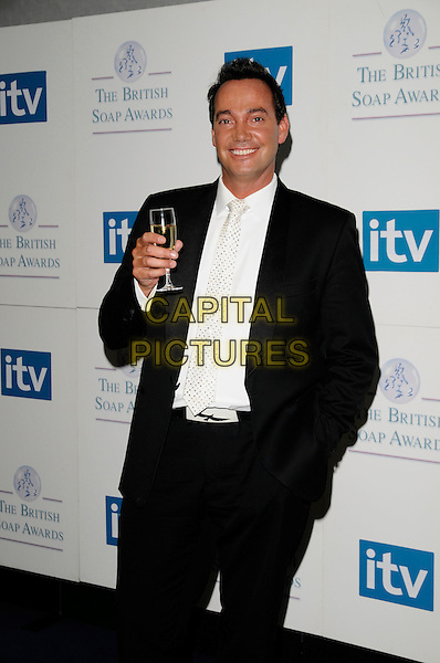 CRAIG REVEL HORWOOD.Attending the British Soap Awards 2008.BBC Television Centre, Wood Lane, London, England, 3rd May 2008.half length black suit white polka dot tie hand in pocket drink beverage .CAP/CAN.© Can Nguyen/Capital Pictures
