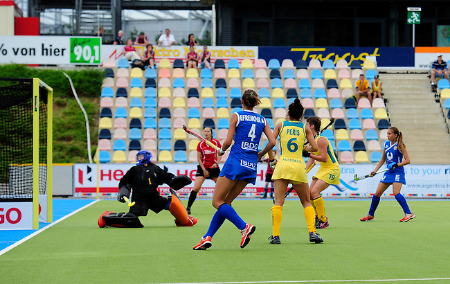 MOENCHENGLADBACH, GERMANY - JULY 28: Match between Australia (yellow) and Russia (blue) in Pool C during the Hockey Junior World Cup at the Warsteiner HockeyPark on July 28, 2013 in Moenchengladbach, Germany. Final score 6-0. (Photo by Dirk Markgraf/www.265-images.com) *** Local caption *** #1 Olga Shugunova of Russia, #4 Anna Efremova of Russia, #6 Brooke Peris of Australia, #19 Kathryn Slattery of Australia
