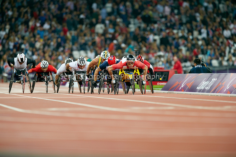 Switzerland's Marcel HUg leads the pack in the secoond last lap of the men's T54 5000m final at the .London Paralympic Games Athletics 2.9.12