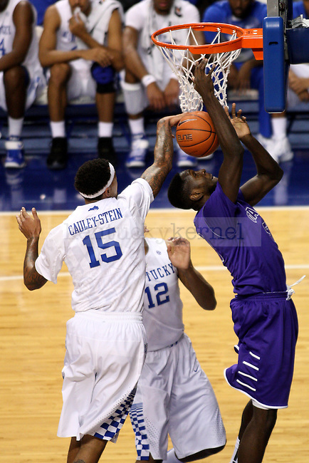 UK's Willie Cauley-Stein (15) blocks a shot by Grand Canyon's Tobe Okafor (50) during the first half of the University of Kentucky vs. Grand Canyon University men's basketball game at Rupp Arena in Lexington, Ky., on Friday, November 14, 2014. UK won 85-45. Photo by Tessa Lighty | Staff