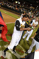 Jacksonville Suns pitcher Jose Urena (34) celebrates after game three of the Southern League Championship Series against the Chattanooga Lookouts on September 12, 2014 at Bragan Field in Jacksonville, Florida.  Jacksonville defeated Chattanooga 6-1 to sweep three games to none.  (Mike Janes/Four Seam Images)