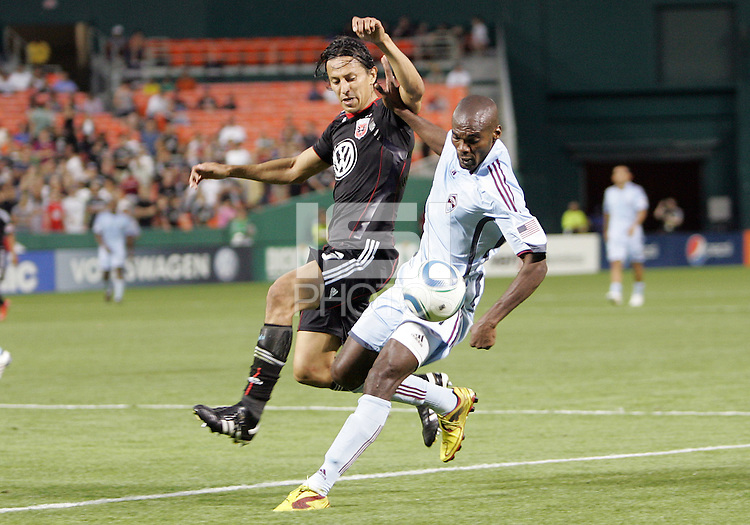 Juan Manuel Pena #3 of D.C. United challenges for the ball with Omar Cummings #14 of the Colorado Rapids during an MLS match on May 15 2010, at RFK Stadium in Washington D.C. Colorado won 1-0.