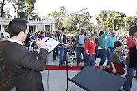 "Johnny Hochgraefe sings ""All Creatures Great and Small"" as members of the San Diego Dachshund Club and their dogs  parade across the stage at the Spreckels Organ stage in Balboa Park, San Diego California, December 23rd, 2007."