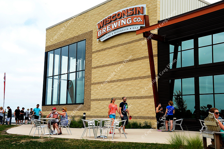 People arrive at Wisconsin Brewing Company to see the creation of Depth Charge Scotch Ale on Sunday, July 12, 2015, in Verona, Wisconsin.